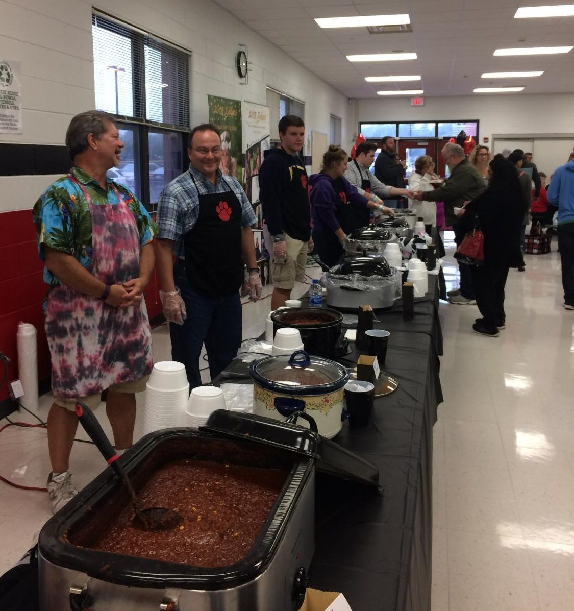 Step right up! Parents and students alike line up their tables for the annual Red Paw Chili Supper. Which Chili was YOUR favorite?